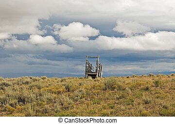 Cattle Chute - An abandoned cattle chute sits alone in a...