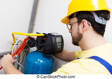 plumber installing new water filtration system