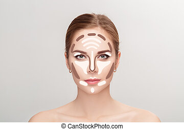 Contouring. Make up woman face on grey background.  Professional