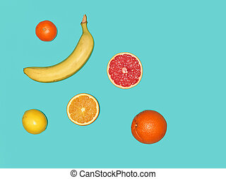 The group of banana and fresh fruits against blue background...