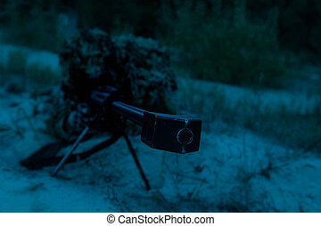 Army sniper on a stakeout - Army sniper with big rifle lying...