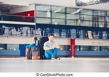 Travelers waiting for departure - Two friends traveling...