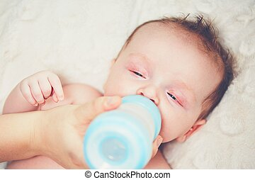 Hungry baby drinking milk