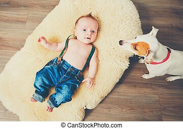 Little boy and dog at home