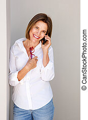 business woman smiling and listening to phone