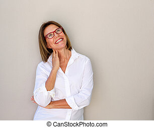 smiling business woman with glasses looking up - Portrait of...