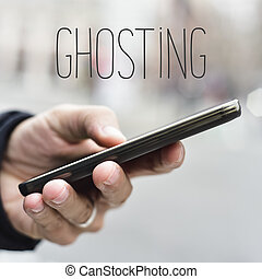 man with smartphone and text ghosting - closeup of a young...