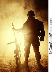 Army sniper in the fire and smoke - Army sniper with large...