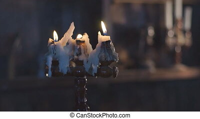 Three wax candles burning in candlestick - Burning candle...