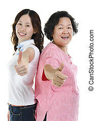 Asian senior mother and adult daughter thumbs up