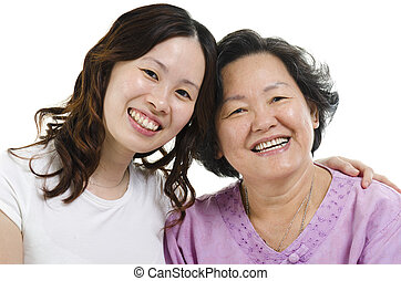 Senior mother and adult daughter headshot