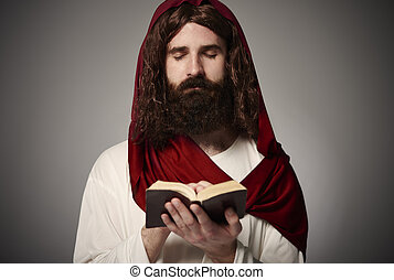 Son of the God praying with Holy Bible