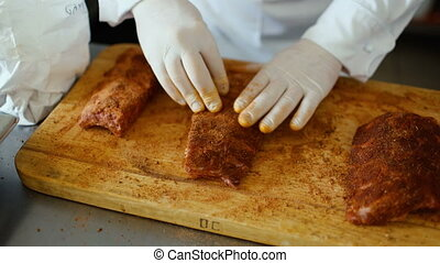 Closeup of professional chef man prepare meat ribs with...