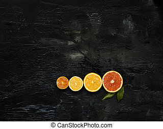 The group fresh fruits against black background - The group...