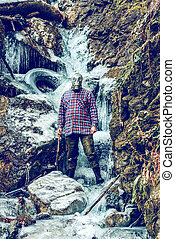 In the frozen waterfall - Man standing on the frozen...