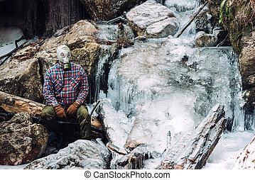 Man by frozen waterfall