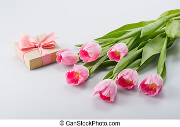 pink tulips and gift - beautiful pink tulips and gift on...