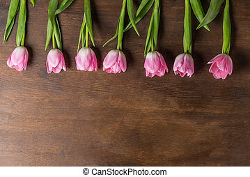 pink tulips on table
