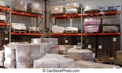 Commodity wrapped in plastic at shipping warehouse -...