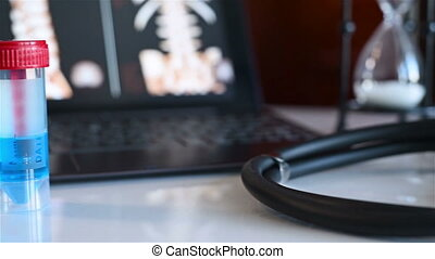 Stethoscope And Patient Records - Laptop With X-rays Of...