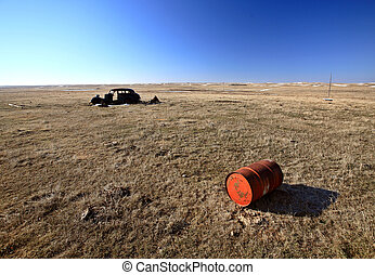 Old Barrell and Abandoned Car in Field