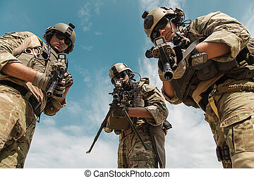 US Army Rangers with weapons - US Army Rangers pointing...