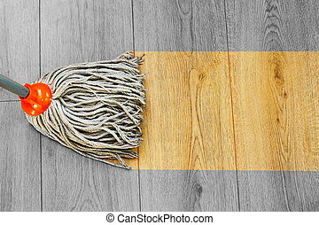 washing dust on wooden floor with mop - process of washing...