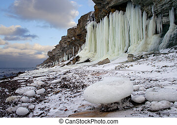 Frozen shoreline extremely cold winter and frosen water in...