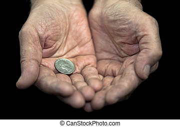 Poverty Old hands with a single coin of 25 cents