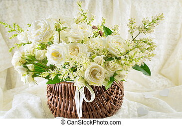 bouquet of white roses  in a wooden backet