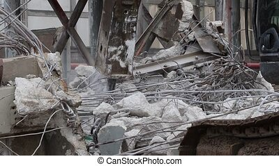 A bulldozer demolishes building on construction site