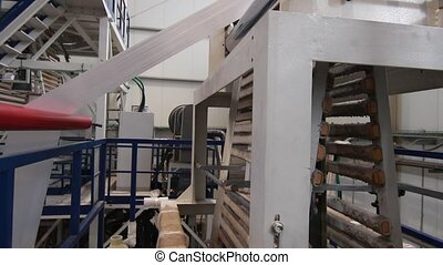 Industrial plastic extruder in a factory - Industrial...