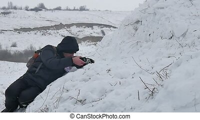 photographer is photographed on the snow and winter snow...