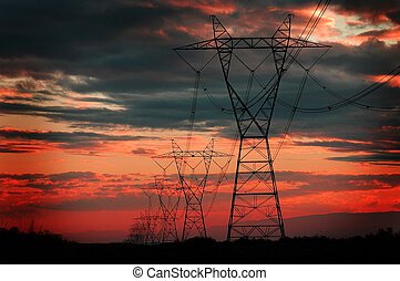Power Lines for Electricity Metal Towers and Sunset -...
