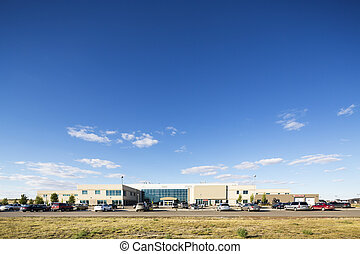 Hospital Building Against Blue Sky - Wide angle shot of...