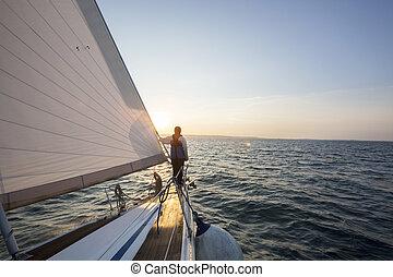 Man Looking At Beautiful Sea From Bow Of Sail Boat - Rear...