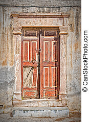 Old Brown Door - Front entrance to an abandoned proberty on...