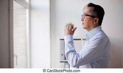 businessman thinking at office - business, people and...