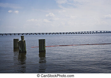 Red Oil Boom and Bridge, Gulf Coast - Red oil boom protects...