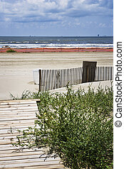 Closed Beach, Gulf Coast - A small boardwalk leads to a...