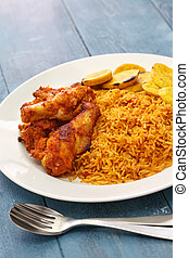 jollof rice with chicken and fried plantain, west african...