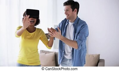 happy couple with virtual reality headset at home -...