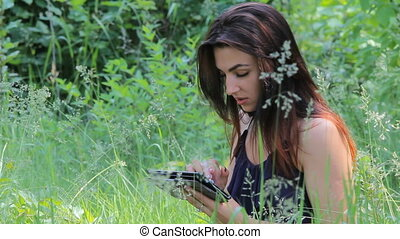 Young Girl Tourist using Map app on Smartphone in the...