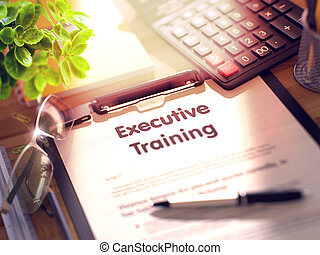 Executive Training - Text on Clipboard. 3D. - Desk with...