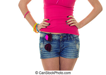 close up of female waist with blue jeans shorts and sunglasses on it isolated on white background