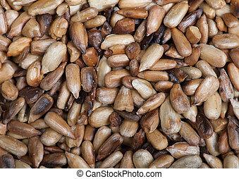 Overcooked peeled sunflower seeds background