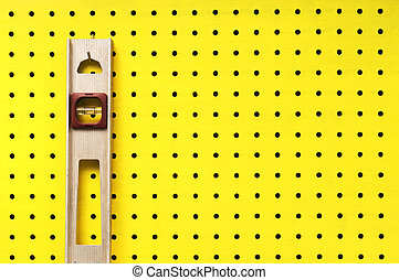 Used level hanging on pegboard - Old level hangs from a hook...
