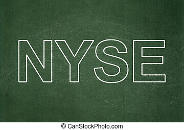 Stock market indexes concept: NYSE on chalkboard background