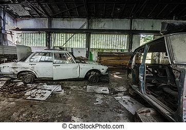 old cars in workshop - old cars in abandoned workshop