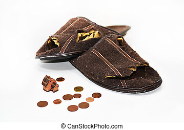 Leaky brown slippers. Abstract composition of poverty....